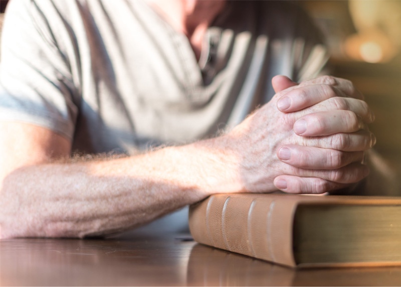 Older Man praying and giving God what is God's: his heart